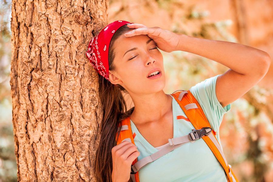 Dehydrated tired hiking woman
